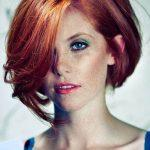 Natural red hair color with golden highlights