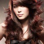 Brown long layered hairstyle with red mahogany strands