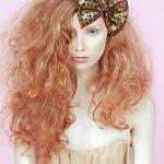 Long curly strawberry red hairstyle