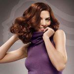 Chestnut hair color with curly bob hairstyle