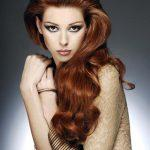 Long red curly hairstyle with chestnut haircolor
