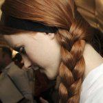 Chestnut hair color with side swept braid