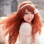 Copper long curly hairstyle