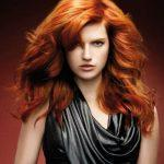 Natural wavy hairstyle with dark ginger hair color