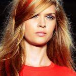Long golden blonde hairstyle with strawberry red chalk strands