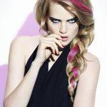 Blonde hairstyle with berry red strands