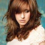 Layered hairstyle with highlights of auburn colors