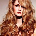 Long curly light copper hairstyle