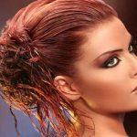 Copper haircolor with wet look updo