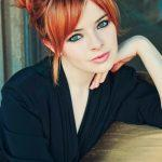 Red updo with side swept bangs