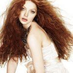 Long wavy curvy light ginger hairstyle