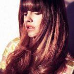 Long auburn hairstyle with bangs