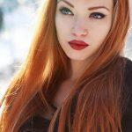 Long ginger hairstyle with highlights