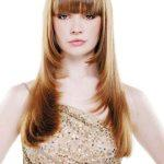 Long strawberry blonde hairstyle with bangs