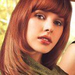Long round copper hairstyle with bangs