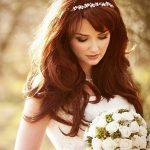 Long brown hairstyle with thick bangs
