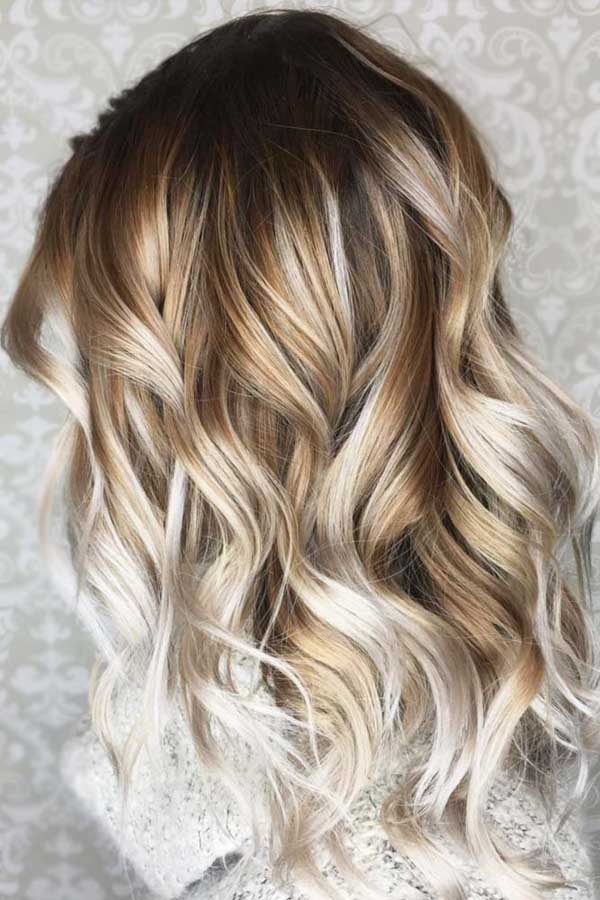 Long wavy layered ash blonde hairstyle